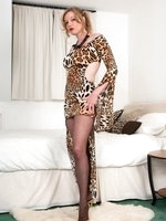 Holly, feeling animalistic in silky leopard print dress and chocolate pantyhose!