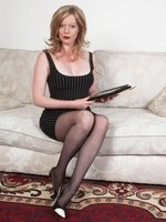 Holly trying to strike a deal in her micro mini and black pantyhose!