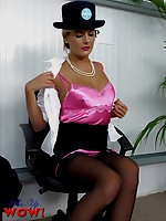 Naughty Air Hostess Victoria in sexy satin pink underwear, suspenders and stockings gives you saucy in-flight treat.