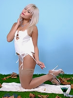 Heavenly Petra Lily So in fetching dress and white corset invites you for a sexy evening striptease.