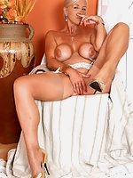 Horny MILF With Big Boobs In Stockings And High Heels