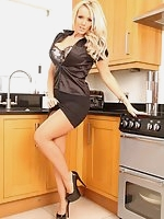Lucy Zara answers a fan's request to wear a satin blouse, so here she goes with a sexy black blouse on and a big silver toy in her kitchen