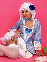 Saucy brunette in fancy dress costume performs a very naughty striptease.