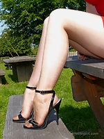 Hot blonde Milf Larissa wants you to join her and her beautiful long shiny legs for some fetish fun