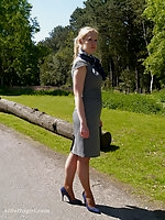 Sexy Milf Iona can't help but show off and tease you in her gorgeous tall blue stilettos