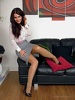 Hot brunette Carla shows off her gorgeous seamed nylons