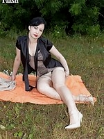 Wanilianna out in the fields showing off her curvy figure in retro corselette
