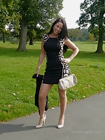 A tight black dress and creamy high stiletto heels gets this dark haired beauty