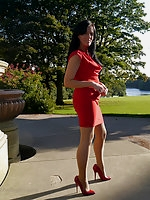 Tricia takes a stroll outdoors wearing a tight red dress and high heel shoes
