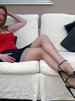 Holly in  miniskirt, heels and nylons
