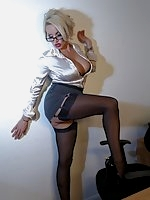Secretary Dannii Harwood in  black lingerie and seamed nylon stockings