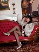 Raven is wearing some fab full fashion nylons and a super black girdle