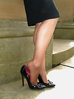 Tricia is outdoors posing in her silky nylon stockings and black high heels