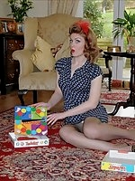 Pinup babe strips playing Twister