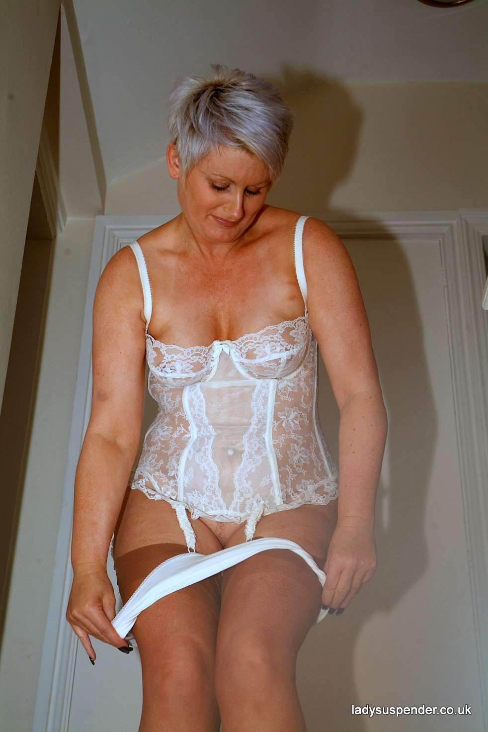 Mature women in girdles and stockings